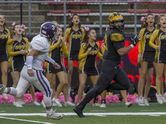 Senior running back/middle linebacker Johnny Buchanan, shown running for a touchdown last week against Rumson-Fair Haven, has been a standout all season for St. John Vianney, which plays at Red Bank Catholic Friday night.