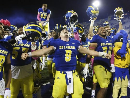 QB J.P. Caruso and the Blue Hens celebrate their OT win.