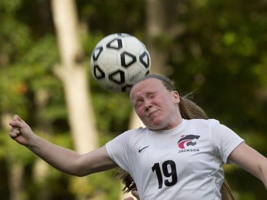 Jackson Memorial's Lindsay Bathmann heads a ball during