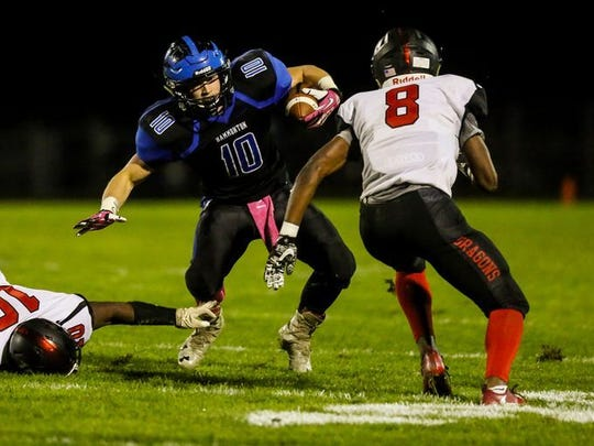Hammonton's Sean Ryker tries to avoid a tackle during a loss to Kingsway on Oct. 20.