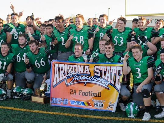 Thatcher players celebrate their 2A football championship