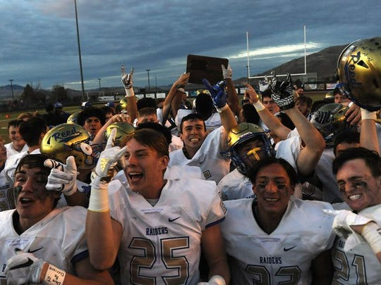 Reed celebrates winning the Northern 4A Region football title last fall.