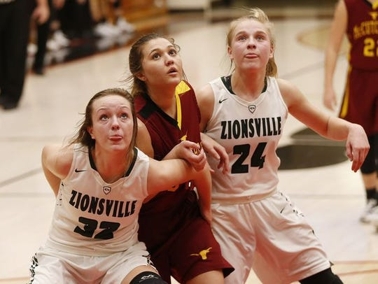 Zionsville's Maddie Nolan and Katey Richason blocked