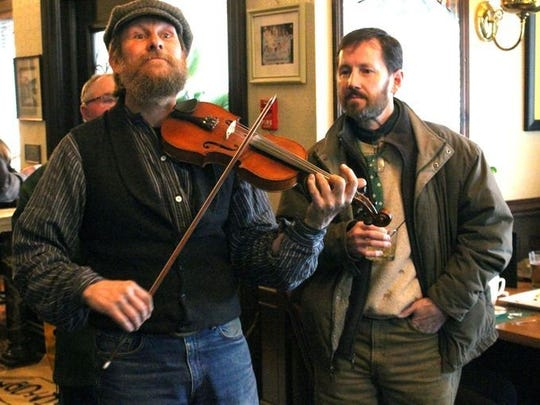 Matt Harvey, fiddler extraordinaire, of the Drowsy Maggies after the Irishmans Walk in Plymouth at 52 Stafford, March 2017. Sheboygan Press Photo
