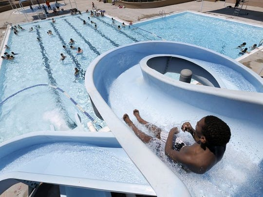 Residents cool off at Nations-Tobin Pool in Northeast El Paso.