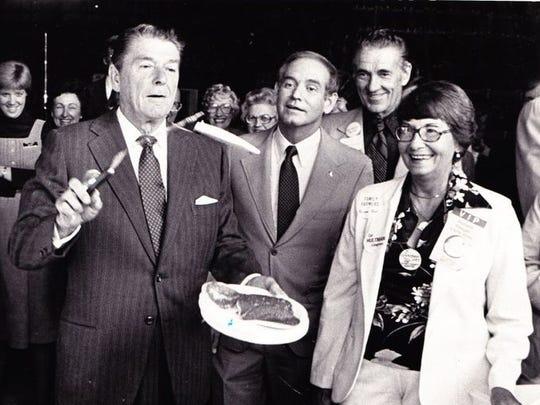 Ronald Reagan flips pancakes for breakfast next to  Gov. Robert Ray at Robert Lounsberry's farm near Nevada, Ia., in September 1980.