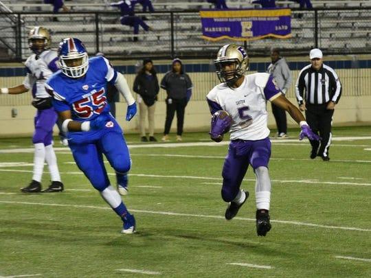 Woodlawn's Thomas Brown tries to track down a quarterback