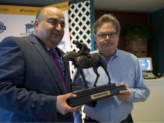 Daily Racing Form writer Jim Dunleavy (right) is presented