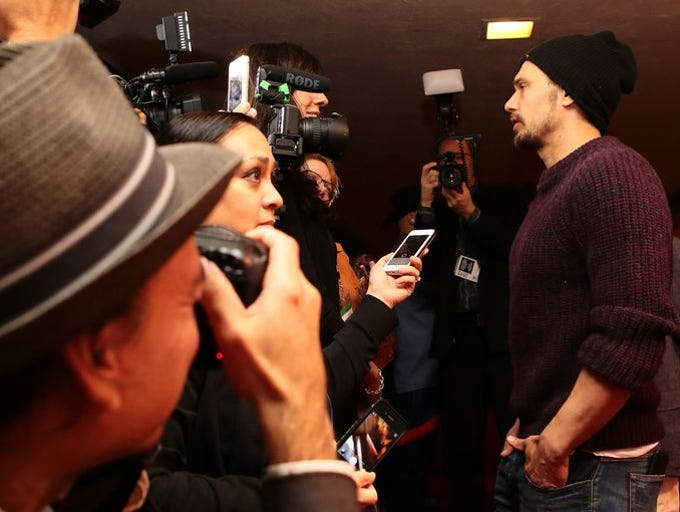 Xochitl Pena interviewing James Franco on the red carpet