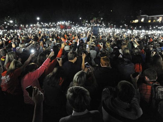 Clemson students hold cell phones during a vigil on Clemson's Bowman Field Tuesday, September 23, 2014 for fellow student Tucker W. Hipps who's body was found the day before  in Lake Hartwel