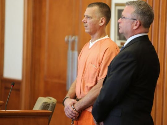 Todd Shaw listens to court proceedings with his lawyer,