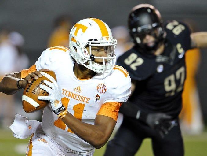 Tennessee quarterback Joshua Dobbs (11) rolls out to pass at Vanderbilt Stadium on Saturday Nov. 29, 2014.