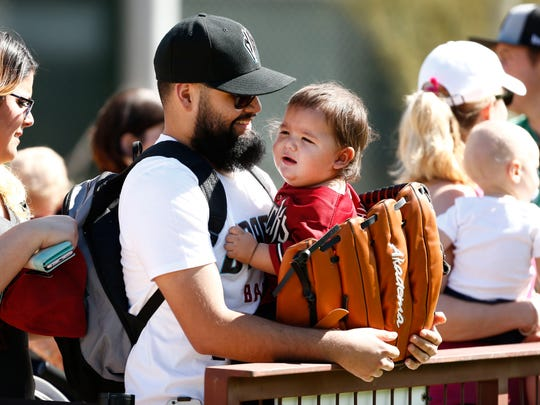 Diamondbacks fan Nore Ramos from Phoenix holds his