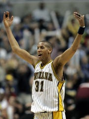 Reggie Miller reacts to a defensive stand by the Indiana Pacers.