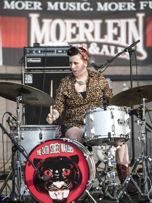 Lindsay Beaver plays drums on the Budweiser Main Stage.