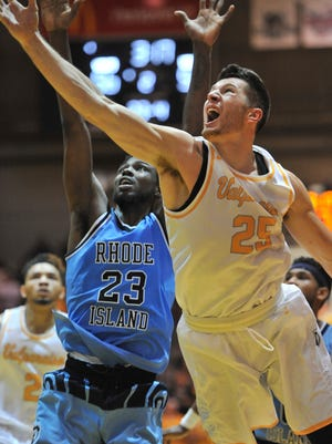 Valparaiso forward Alec Peters (25) shoots in front of Rhode Island forward Kuran Iverson during the second half of an NCAA college basketball game.