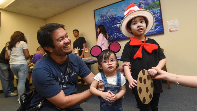 JD San Pedro with his kids Jayden, 2, and Austin, 5, during Dr. Seuss' 114th Birthday Celebration at the Nieves M. Flores Memorial Library on March 3, 2018.