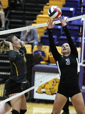 Thomas Metthe/Reporter-News Wylie's Peyton Cunningham (3) sets the ball during the third game of the Lady Bulldogs' win on Tuesday, Oct. 18, 2016, at Wylie High School.