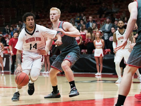 James McGee drives during SUU's 66-62 win over Eastern