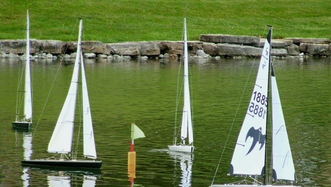 Looking like America's Cup racers, these four model boats bunched up for an exciting start.