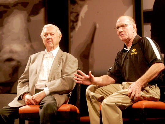 """Legendary Waterloo High School wrestling coach Bob Siddens talks with Dan Gable during """"This Is Your Life, Dan Gable"""" at the Coralville Marriott Hotel and Convention Center kicking off FryFest 2011 on Friday, September 2 in Coralville, IA."""
