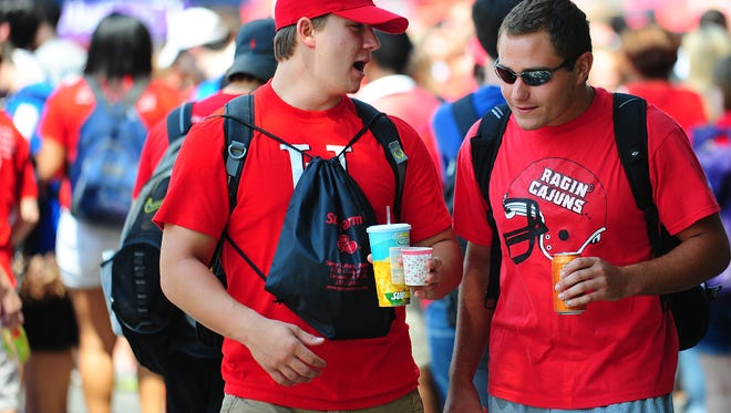 UL students Andrew Mayer and Ross Robin converse as they walk through the annual Block Party on the UL Lafayette campus in Lafayette, LA, Friday, Aug. 30, 2013.  Paul Kieu, The Advertiser