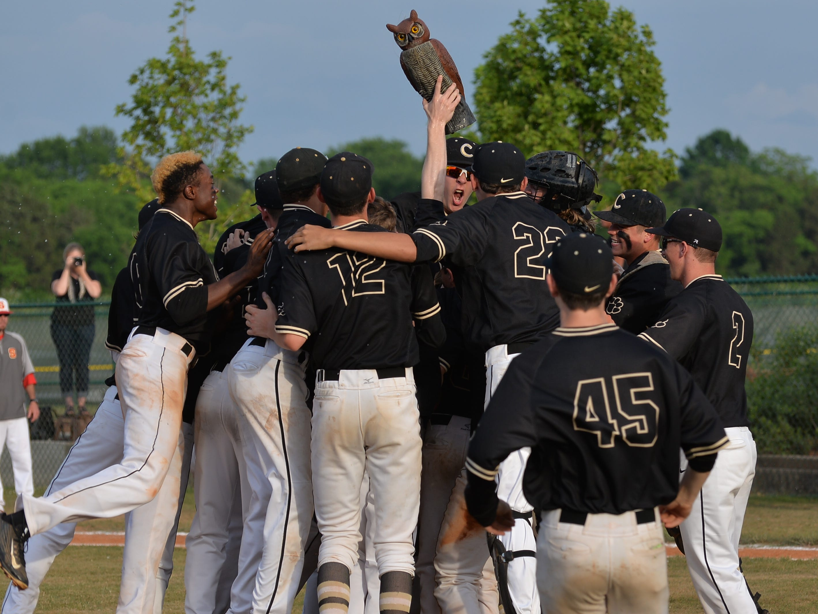Central Magnet's baseball team celebrates its 4-0 win in Friday's Class AA sectional to qualify for their third straight state tournament.