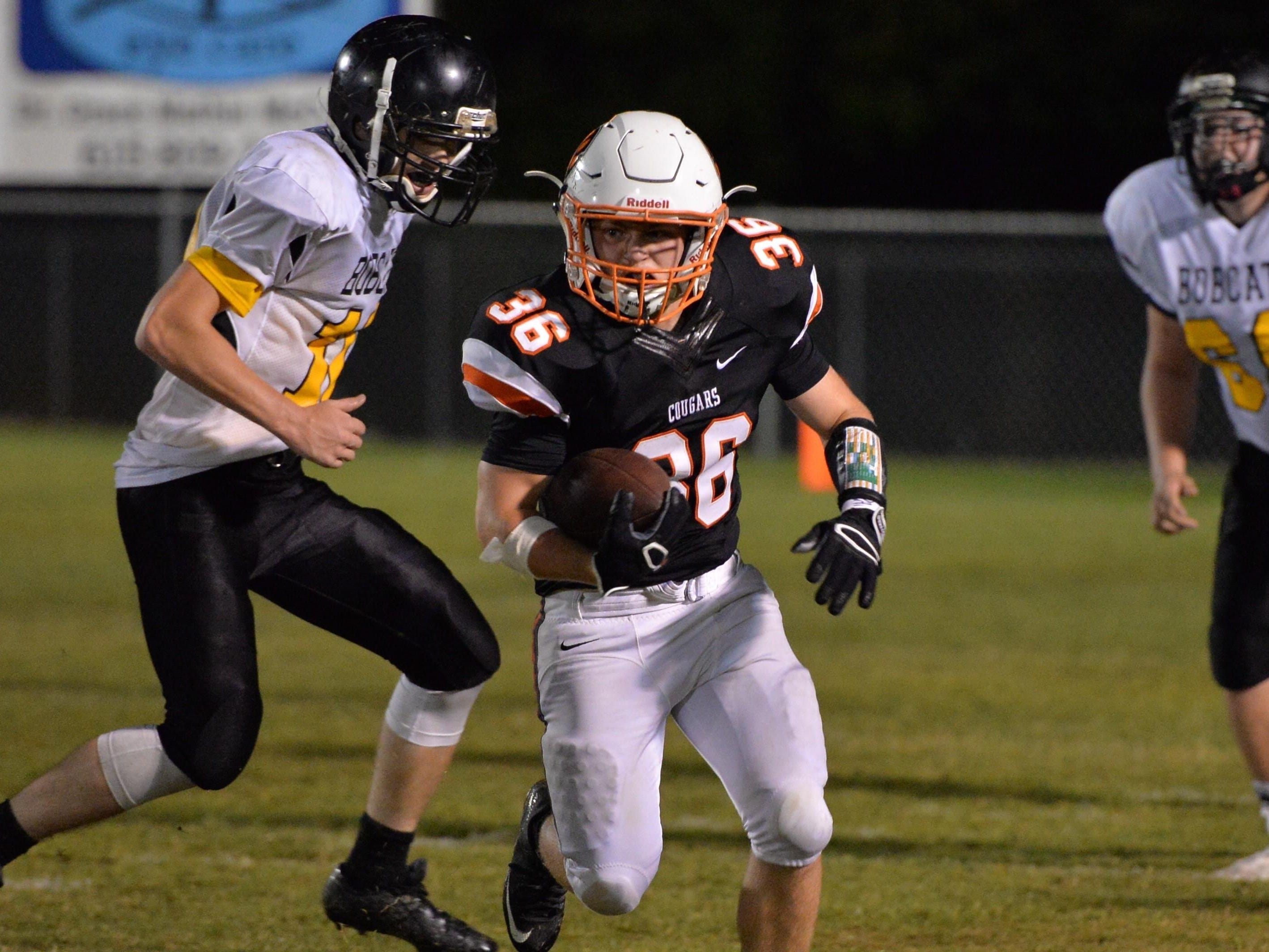 Parker Bates runs the ball in MTCS' rout of Pickett County on Friday.