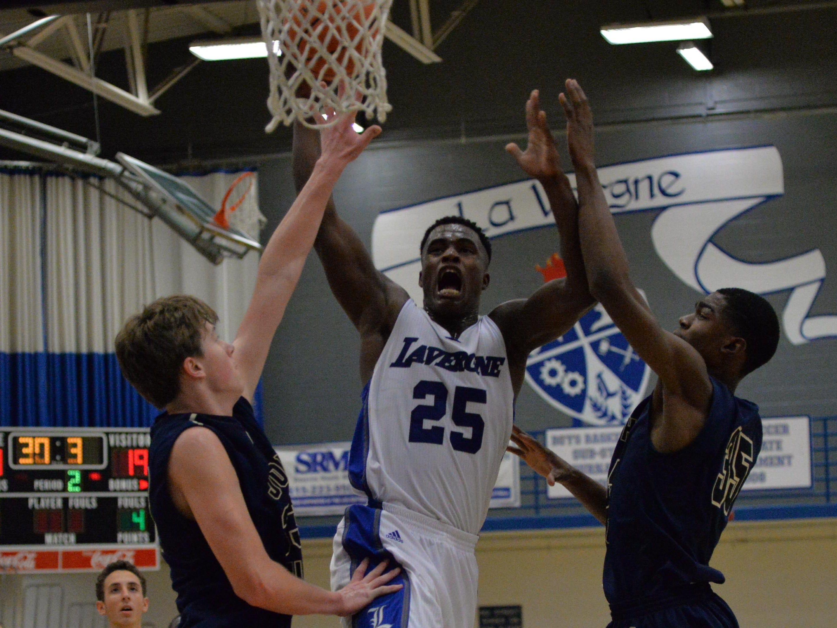 La Vergne's Maleik Gray (25) goes up for a shot against Pope John Paul II during Friday's non-district game.