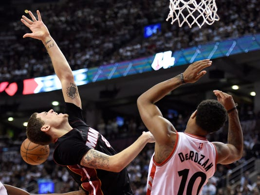 Toronto Raptors' DeMar DeRozan (10) defends Miami Heat's Tyler Johnson during the second half of Game 5 of the NBA basketball Eastern Conference semifinals, Wednesday, May 11, 2016, in Toronto. (Frank Gunn/The Canadian Press via AP)