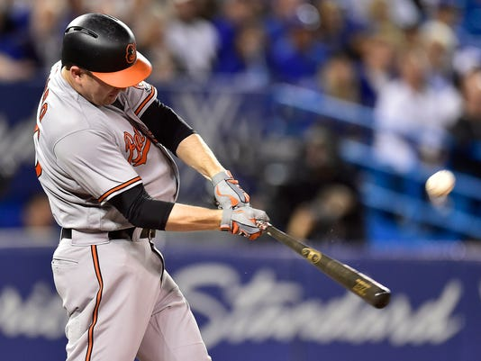 Baltimore Orioles' Mark Trumbo hits a solo home run against the Toronto Blue Jays during fifth inning American League MLB baseball action in Toronto on Monday, Sept. 11, 2017. (Frank Gunn/The Canadian Press via AP)