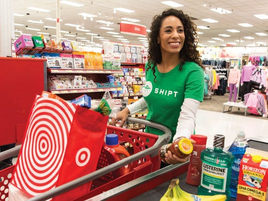 A Target Shipt employee checking out a digital order for delivery.
