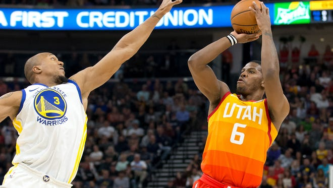 Utah Jazz guard Joe Johnson (6) shoots the ball against Golden State Warriors forward David West (3) during the second half at Vivint Smart Home Arena.
