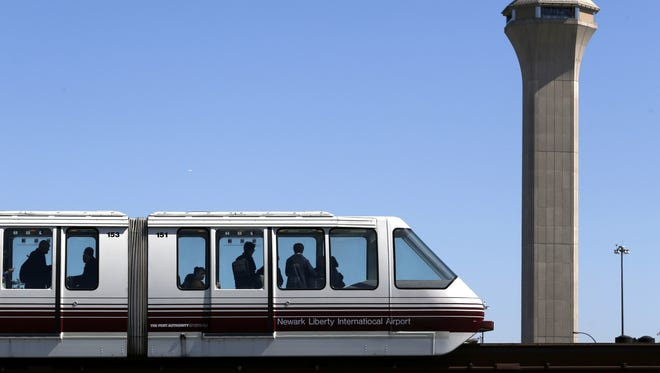 Travelers ride on the AirTrain at Newark Liberty International Airport on April 24, 2014.