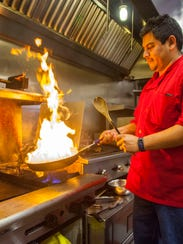 General manager Octavio Mejia cooks up a meal at Pisco