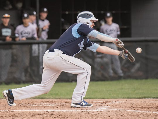 Bunting the ball for Livonia Stevenson is Mark Pettersson (17).