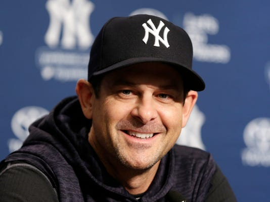 Yankees manager Aaron Boone speaks to reporters before the scheduled New York Yankees home opener against the Tampa Bay Rays at Yankee Stadium Monday, April 2, 2018 in New York. The game was postponed until Tuesday due to weather. (AP Photo/Seth Wenig)