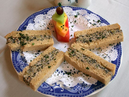 Mixed-Olive-Nut Spread is used to make finger sandwiches