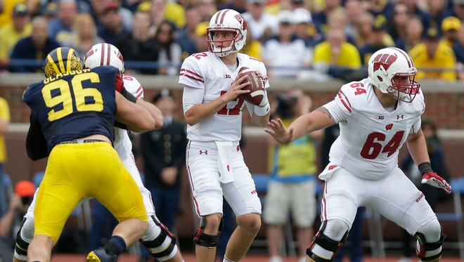 Wisconsin Badgers quarterback Alex Hornibrook looks to pass against the Michigan Wolverines.