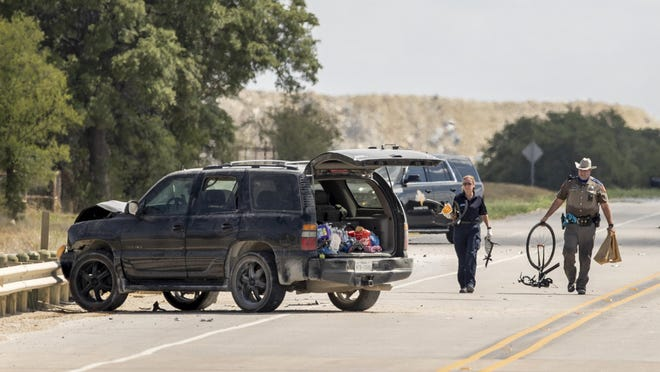 A DPS trooper takes away a bicycle after a fatal hit and run on Ronald Reagan Boulevard near County Road 238 north of Georgetown on Sunday.  According to DPS Sgt. Deon Cockrell, a man driving south on Ronald Reagan Boulevard struck and killed another man riding a bicycle around 9 a.m.   The driver fled the scene on foot. The suspect was not located during initial search, however is believed to have been positively identified by investigators, Sheriff Robert Chody said on Twitter.