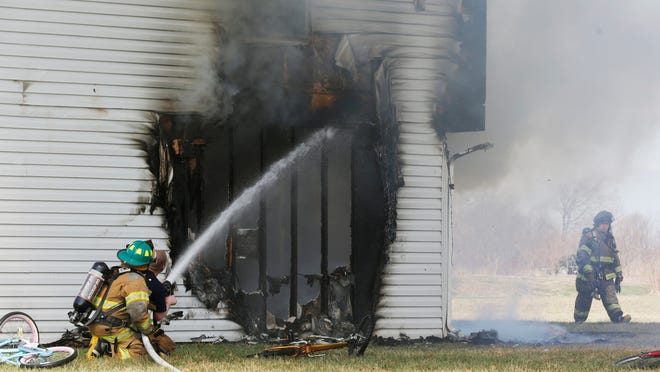 John Terhune/Journal & CourierThree-year-old twin sons of Brandon Abbott perished in the April 4, 2014, fire at 10790 Brandy Kay Ct., a house he rented. TOP: The April 5 fire was at a house rented by Brandon Abbott. ABOVE: The Tippecanoe County coroner has determined that Landon and Liam Abbott, 3-year-old twins, died as a result of the fire. File photos/Journal & Courier Firefighters battle a house fire Saturday, April 5, 2014, at 10790 Brandy Kay Court near Mulberry. Two young children who were initially trapped in the house at the time of the fire, were taken to area hospitals for treatment.