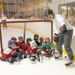 "Coach Rick Kuhar gives instruction on running a drill during a learn-to-play hockey program in 2006 at The Rink in Lansing. The Ithaca Youth Hockey Association is conducting this year's ""Try Hockey"" day from 9-10 a.m. Sunday at Cass Park."