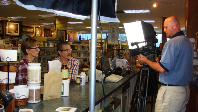 """Steve Rose, center, is a local author who has adapted his book, """"Coincidence or Godincidence"""" for TV."""