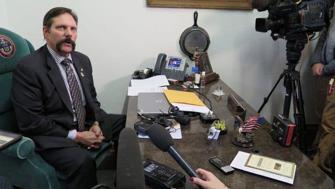 Republican State Sen. Randy Baumgardner speaks to the media regarding sexual misconduct allegations that he denies, Tuesday, Feb. 13, 2018, in Denver.