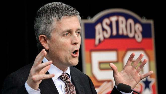 FILE - In this Dec. 8, 2011, file photo, Houston Astros general manager Jeff Luhnow answers a question during a baseball news conference in Houston. The Cardinals have become a model of success by mixing traditional scouting with a heavy dose of analytics, an approach that grew as Jeff Luhnow rose to power in the front office a decade ago. Luhnow took that skill to the Astros, whose player database was allegedly hacked by his former colleagues in St. Louis.
