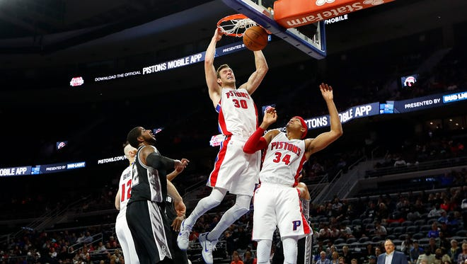 Pistons forward Jon Leuer (30) dunks against the Spurs in the second half of a preseason game Monday at the Palace.