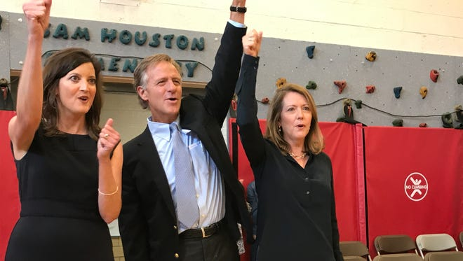 """Gov. Bill Haslam and his wife, Crissy (right), join first-grade teacher Elisabeth Bellah in singing """"Rocky Top"""" during the Haslams' visit to Sam Houston Elementary School in Maryville on Friday."""