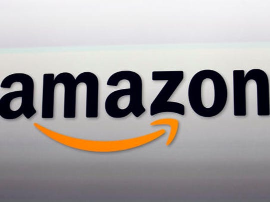 FILE - This Sept. 6, 2012, file photo, shows the Amazon logo in Santa Monica, Calif. Movie fans can watch a variety of Oscar-nominated flicks online from their couches for a fee. A number of full-length movies and shorts nominated in various categories are available through an all-you-can-watch subscription - Netflix, Hulu, Amazon Prime or HBO Now.