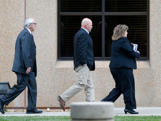 Joey Kyle (center) walks in the the Federal Courthouse