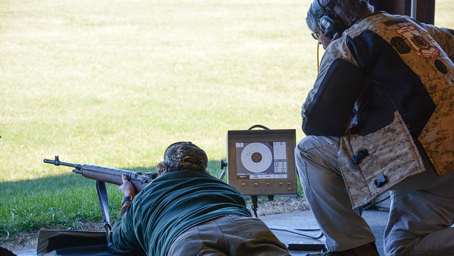 A monitor that displays instant scores once a shot is fired upon the target is placed next to each shooter on the firing line.